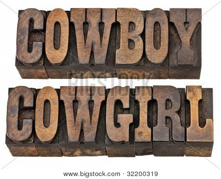 cowboy and cowgirl - isolated words in vintage letterpress wood type, French Clarendon font popular in western movies and memorabilia