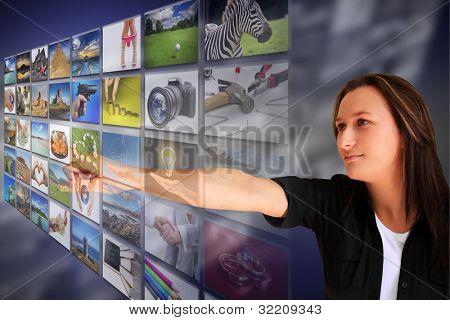 Woman pressing a virtual screen button