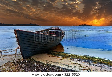 The old fishing boat in the Baltic beach