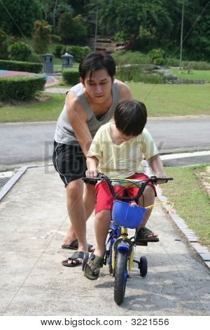 Father Teaches Son Cycling
