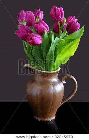 lila tulips in ceramic,brown pitcher