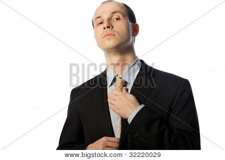 Businessman Tying Gallow Tie