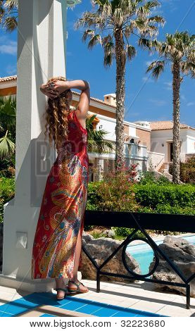 Attractive Woman In Greek Style Looking To Magnificent Garden