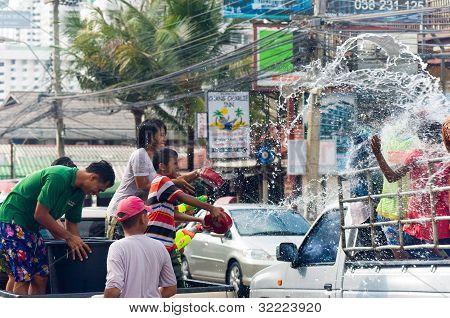 Thai Family Splashing Water On Songkran Festival