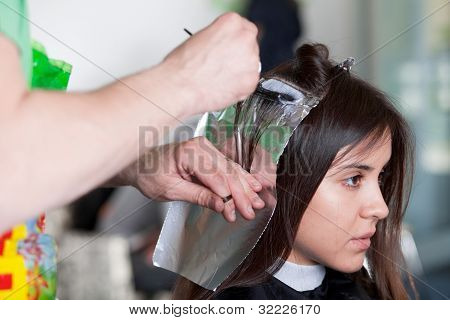 Hairdresser Applying Color To Customer's Hair. Selective Focus.