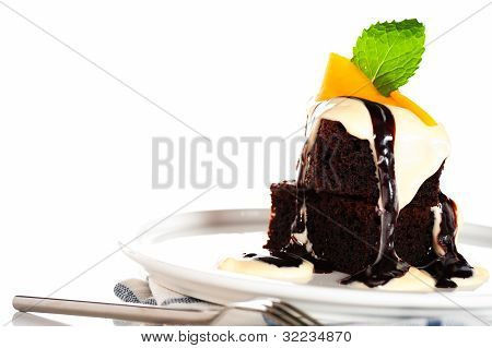 A Plate With 2 Pieces Brownies White And Brown Chocolate And Mango On White Background As A Studio S