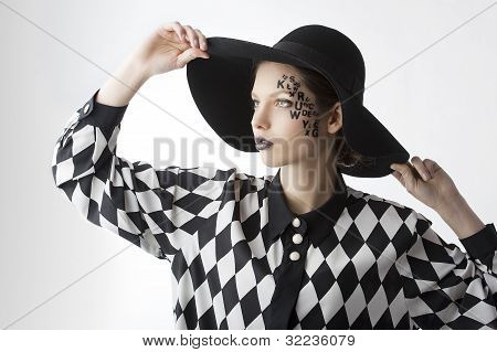 The Letter On The Face Creative Makeup Girl, She Takes The Edges Of The Hat