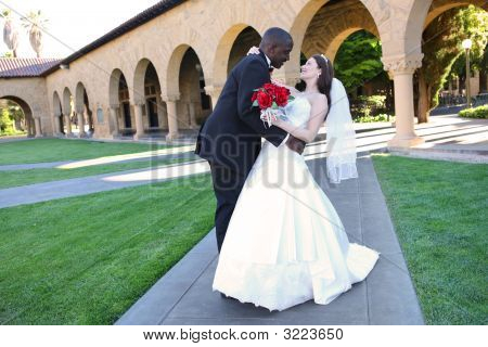 Attractive Interracial Wedding Couple At Church