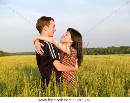 Teen Couple Embrasing In Field