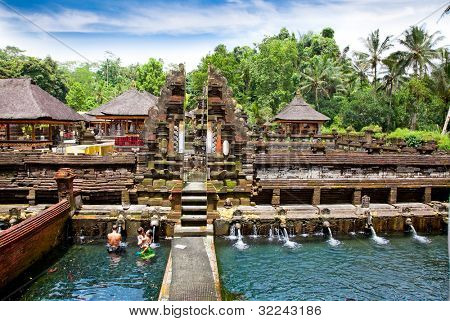 BALI, INDONESIA-JANUARY 20: People praying at holy temple  Gunung Kawi during the Nyegara Gunung ceremony on January 20, 2012 in Padangbai,  Bali, Indonesia