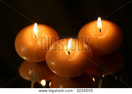 Candles On Reflected Surface