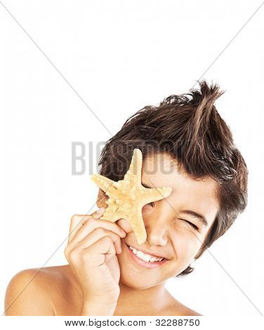 Happy face cute boy with starfish, closeup portrait of preteen brunette child, male kid model having fun, isolated on white background, summer travel and beach vacation