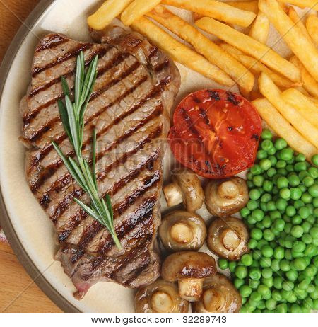 Chargrilled sirloin steak dinner with fries.