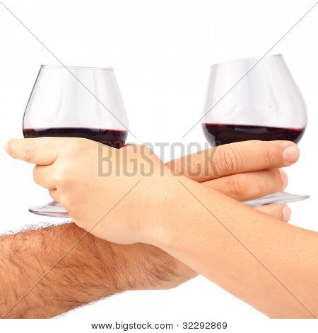 Man and woman's hands holding red wine glasses isolated on white