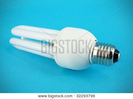 CFL bulb on  blue backdrop