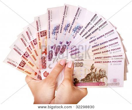 Female hand with  money Russian rouble. Isolated.