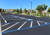 Freshly Resurfaced And Repainted Handicap Parking Space In A Parking Lot. The Number Of Handicap Spa poster