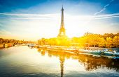 Paris Eiffel Tower Reflecting In River Seine At Sunrise In Paris, France. Eiffel Tower Is One Of The poster