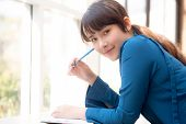 Beautiful Portrait Young Asian Woman Writer Smiling Thinking Idea And Writing On Notebook Or Diary W poster