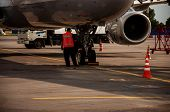Pre-flight Preparation Of The Aircraft At The Airport. The Work Of Engineering Ground Services Of Th poster