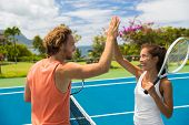 Fitness sport tennis couple giving high five energetic after fun mixed double game. Tennis players f poster