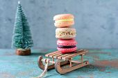 Stack Of Sweet French Macarons Cake On A Decorative Sled On Blue Background. Top View, Copy Space Fo poster