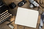 Vintage Retro Typewriter, Analog Film Camera And Open Notebook With Fountain Pen On Brown Wooden Tab poster