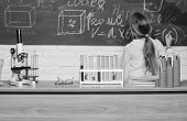 Kid Near School Chalkboard Background Defocused. School Biology Lesson. Kid Study Biology With Equip poster