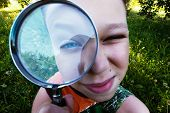 Boy Looking At You Through Magnifier. Charming Schoolboy Exploring Nature. Kid Discovering World Wit poster