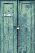 Old Locked Door With Peeling Paint, Padlock And Chain In Venice, Italy poster