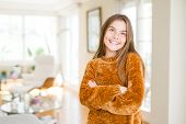 Beautiful young girl kid at home smiling looking side and staring away thinking. poster