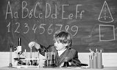 Boy Near Microscope And Test Tubes In School Classroom. Kid Study Biology Chemistry. Knowledge Day.  poster