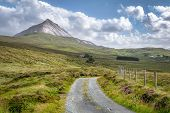 A Remote Country Road That Leads Up To Mount Errigal In County Donegal Ireland poster