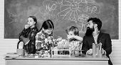 Man Bearded Teacher And Pupils With Test Tubes In Classroom. School Chemistry Lab. Science Involves  poster