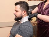 Stylist Preparing Male Befor Haircutting, Close Up View. Stylists Hands In Black Rubber Gloves. Phot poster