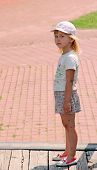 Offended Girl Standing On Street. Sad Child Standing In Street. Upset Girl Silently Standing On Stre poster