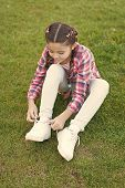 Enjoying Leisure Time. Small Girl Relax On Green Grass. Parks And Outdoor. Spring Nature. Summer Pic poster