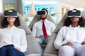 Group Of Colleagues In Vr Headsets Watching Virtual Presentation Together. Business Man And Women We poster