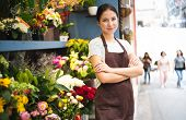 Young Female Business Owner Standing At Her Flower Shop. Young Entrepreneur Leaning With Her Arms Cr poster