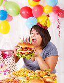 pic of bag-of-dog-food  - Woman eating hamburger at birthday - JPG