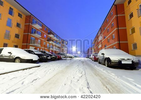 Snowy street with cars at winter in Poland