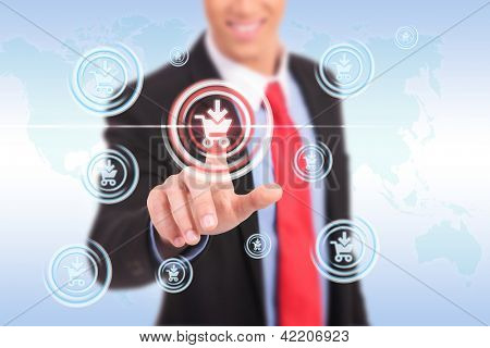 Businessman pressing promotion and shopping button on a futuristic interface