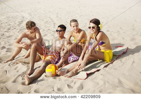 group of young people at the beach