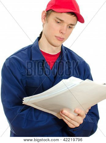 Young Tradesman In Uniform Reading Manual. Isolated On White