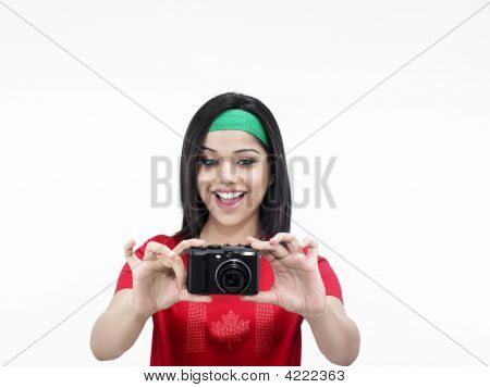 Asian Woman With A Hot Shot Camera Talking Picture