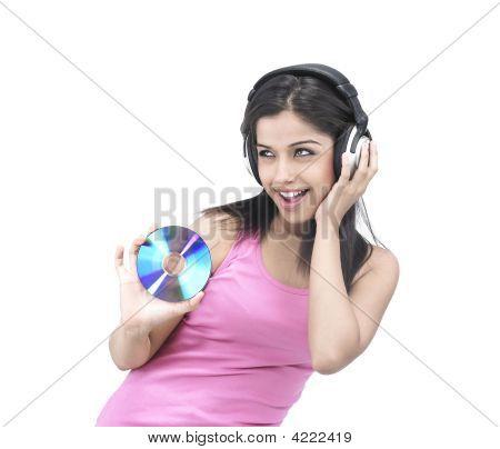 Asian Girl Enjoying Music