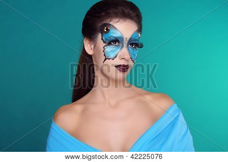 Butterfly Fashion Makeup On Face Beautiful Woman. Art Portrait.