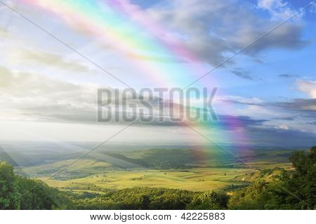 beautiful spring landscape with rainbow