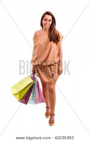 Lovely woman walking with shopping bags over white background