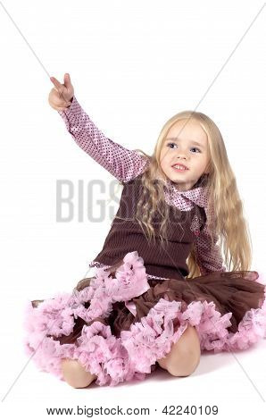 Little girl in brown and pink clothes
